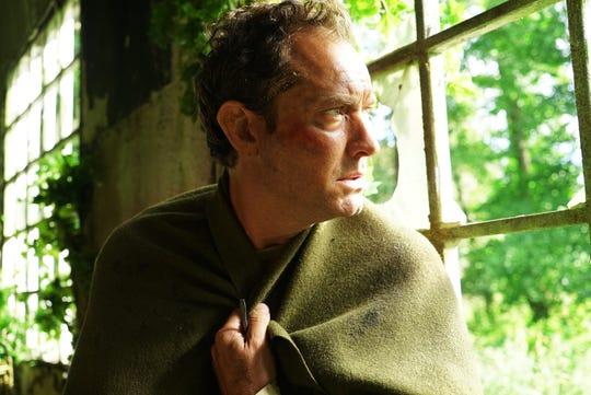 "Jude Law stars as a Londoner who finds himself on an English island where the townsfolk have some serious strange customs in HBO's psychological-thriller miniseries ""The Third Day."""