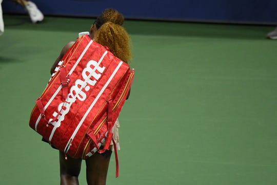 Serena Williams walks off the court after her three-set loss to Victoria Azarenka in their U.S. Open semifinal.