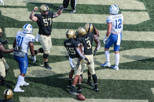 Armyrunning back Sandon McCoy (3) celebrates his touchdown with teammates during the team's game against Middle Tennessee at Michie Stadium.