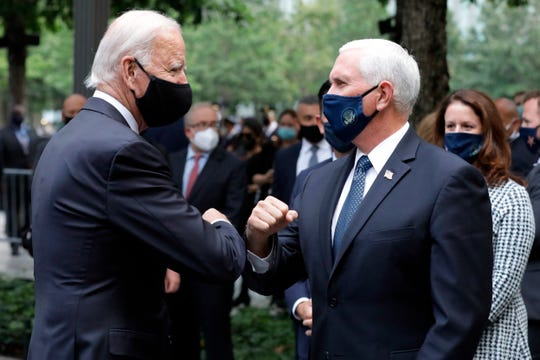 Democratic presidential candidate former Vice President Joe Biden greets Vice President Mike Pence at the 19th anniversary ceremony in observance of the Sept. 11 terrorist attacks at the National September 11 Memorial & Museum in New York, on Friday, Sept. 11, 2020.