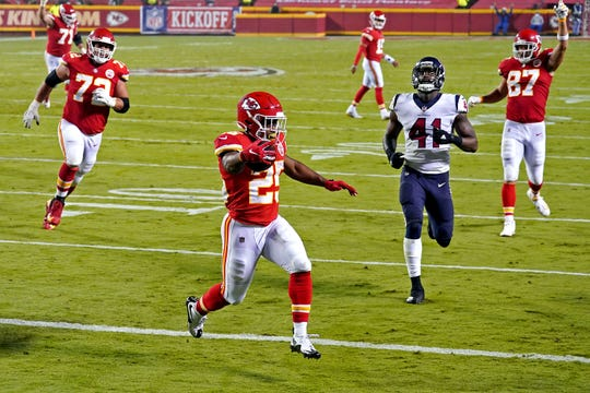 Kansas City Chiefs running back Clyde Edwards-Helaire (25) scores a touchdown against Houston Texans linebacker Zach Cunningham (41) during the second half at Arrowhead Stadium.