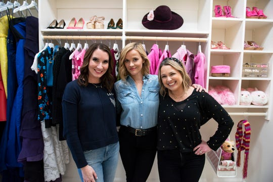 "For the premiere episode of Netflix's ""Get Organized with The Home Edit,"" Clea Shearer, left, and Joanna Teplin, organize a closet for actress Reese Witherspoon."