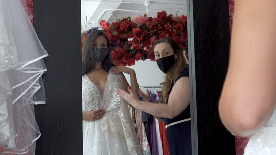 Adrienn Braun works with her client Niki Siracusa, who had to delay her wedding three times due to COVID-19. Siracusa now plans to get married in March of 2021.