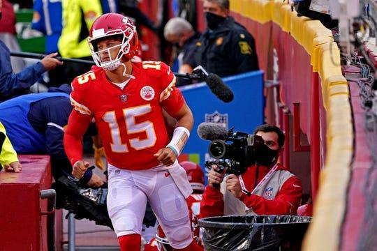Kansas City Chiefs quarterback Patrick Mahomes runs onto the field to warm up before the game against the Houston Texans at Arrowhead Stadium.