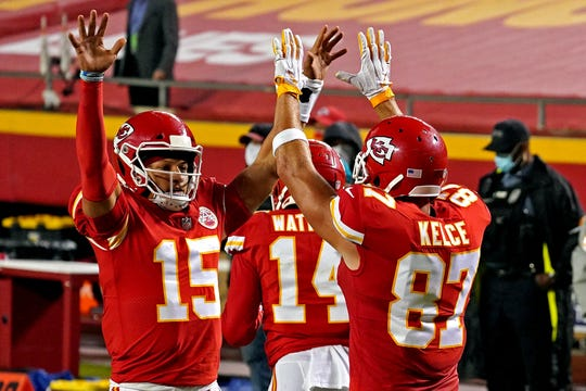 Kansas City Chiefs quarterback Patrick Mahomes (15) and tight end Travis Kelce (87) celebrate after a touchdown  during the first half against the Houston Texans at Arrowhead Stadium.