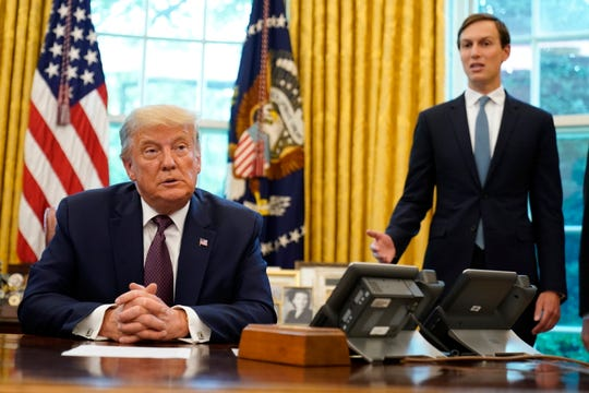 President Donald Trump listens as Jared Kushner speaks in the Oval Office of the White House on Friday, Sept. 11, 2020, in Washington.