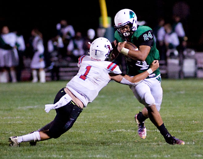 West Branch's Alek Wilson works to break a tackle by Alliance's Braidyn Hartsoe Friday, September 11, 2020 in an Eastern Buckeye Conference game at Clinton Heacock Stadium.