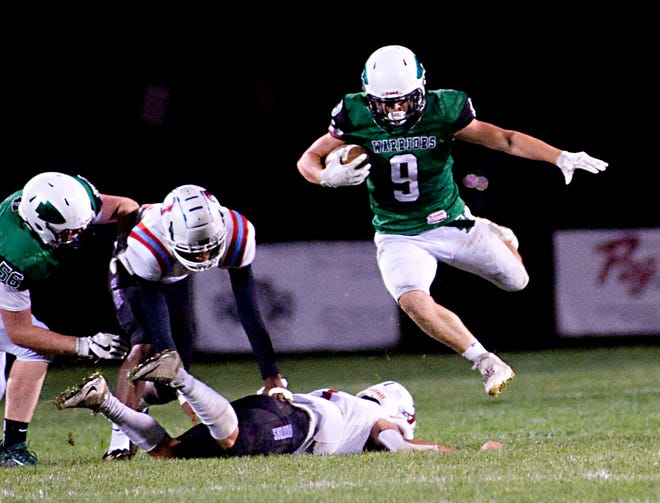West Branch's Steven Marra leaps over an Alliance defender Friday, September 11, 2020 in an Eastern Buckeye Conference game at Clinton Heacock Stadium.