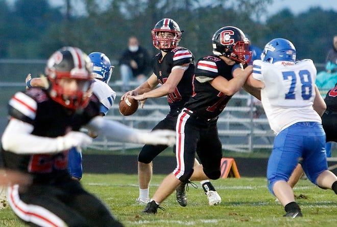 Crestview quarterback Ross Kuhn (10) throws a pass against Western Reserve on Sept. 11 at Scott Bailey Memorial Field.