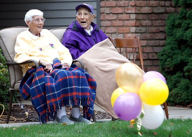 Ruth and Fred Martinelli enjoy the drive-by celebration for Ashland University's 100th anniversary of its first football game on Friday, Sept. 11, 2020.