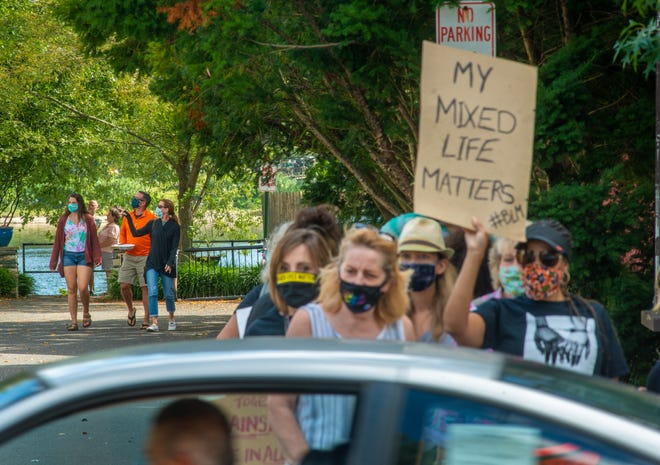 A group of people believed to be Fred's customers exit the location during a protest of an alleged offensive sign at Fred's Breakfast Club of New Hope on Saturday.