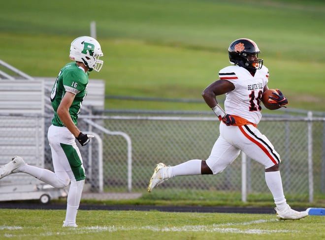 Riverside's Kobe Andreas (16) chases Beaver Falls' Joshua Hough into the end zone during Friday's game at Riverside.