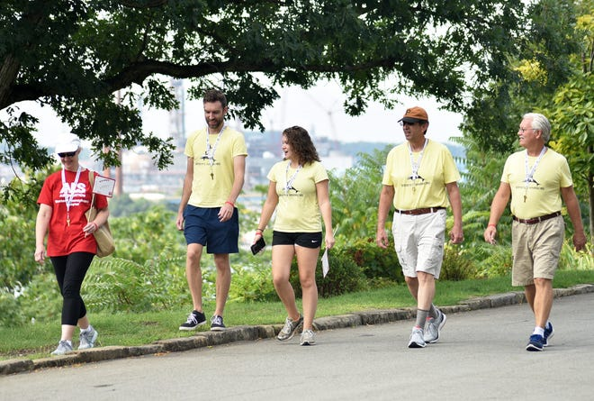 The Baker and Thomas families walk Saturday morning along River Road in Beaver in memory of Wendy Thomas, who died of ALS in 2017. Pictured, from left, are Connie Baker, Dave Thomas, Barbara Thomas, Bob Baker and Jim Thomas. Barbara has her cellphone on, so other family members from all over the United States are virtually walking with them.