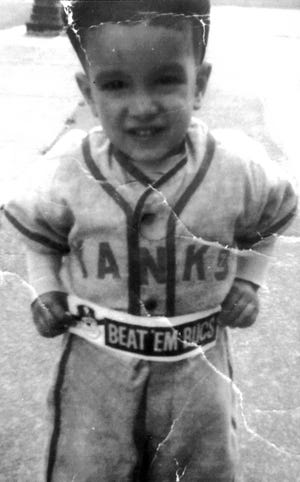 """In 1960, 3-year-old Artie DeSisto dressed in a New York Yankees uniform but wore a """"Beat 'Em Bucs"""" bumper sticker. The Pirates beat the Yankees in the World Series that year."""