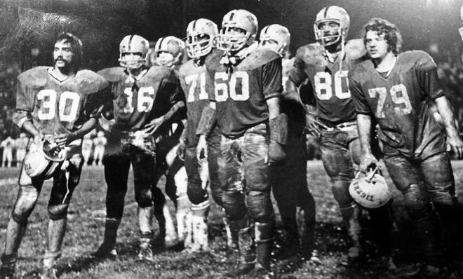 "As a member of the Beaver Falls Fighting Tigers football team, Artie DeSisto, left, helped lead his ""Alley Cats"" defense to a 12-0 win in a muddy downpour at Ellwood City in September 1974."