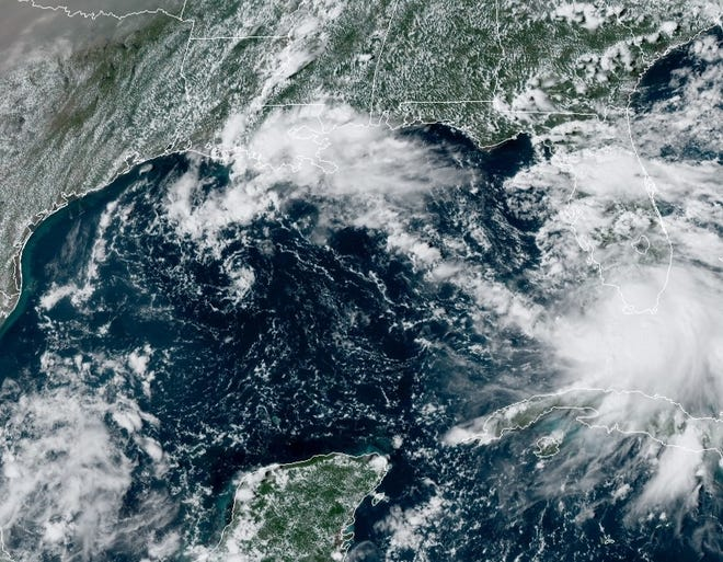 Satellite photo taken Saturday afternoon shows Tropical Storm Sally in southern Florida. Forecasters say the storm will likely strengthen into a Category 1 hurricane in the next few days.