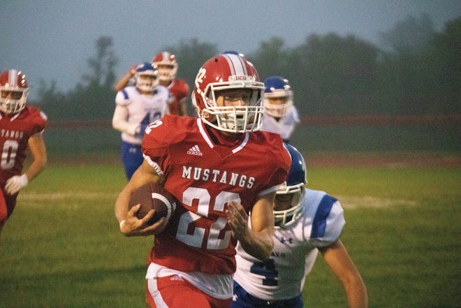 DCG's Jacob Hauschen in action against the Perry Bluejays on Friday, Sept. 11.