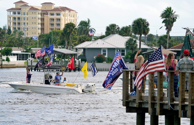 Supporters participate in the Daytona/NSB Trump Boat Rally along the Halifax River on Saturday