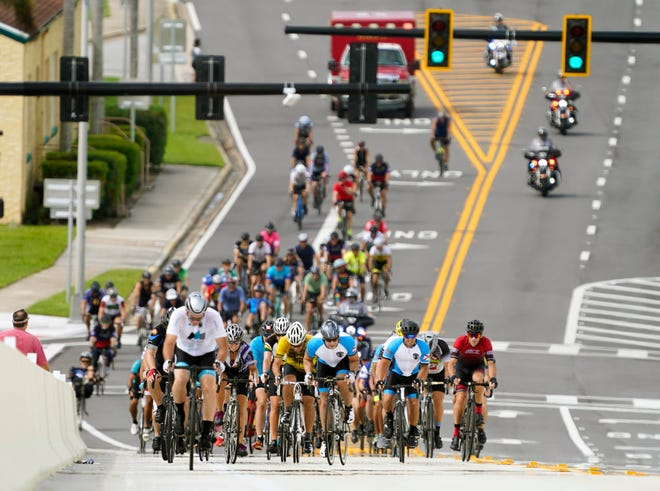 About 150 members of law enforcement and others ride over the Veterans Memorial Bridge in Daytona Beach during the Tour de Force 9/11 Memorial Ride on Saturday. The ride went for 51 miles through coastal Volusia County.