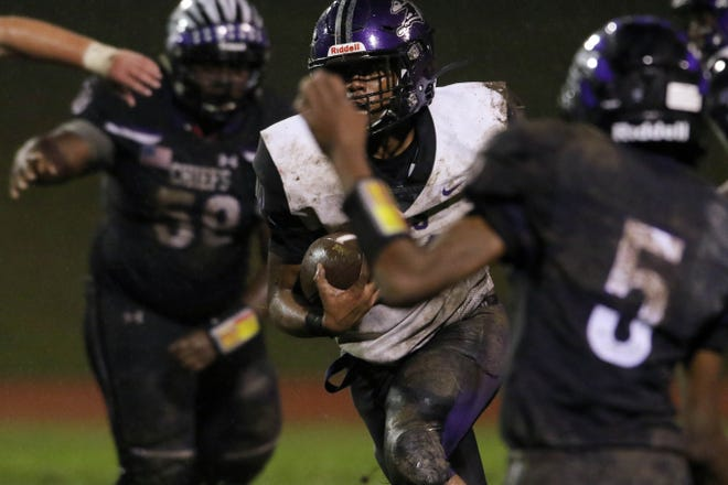 Burlington High School's Ronald Sheard (34) takes the ball down the field during the first half of their game against Keokuk High School, Friday Sept. 11, 2020 in Keokuk.