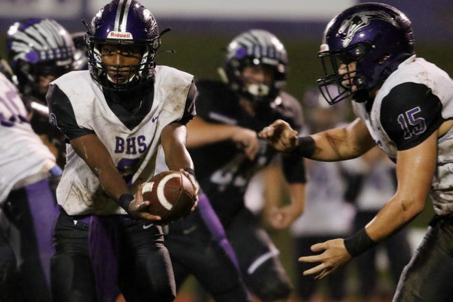 Burlington High School quarterback Kanyae Baker (3) hands the ball off to Nolan Simpson (15) during the first half of their game against Keokuk High School, Friday Sept. 11, 2020 in Keokuk.