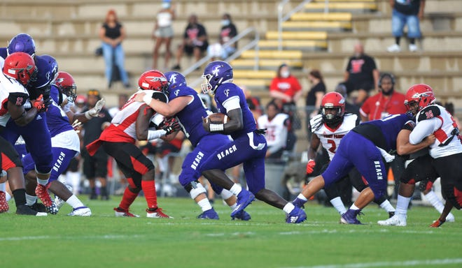 Fletcher running back Myles Montgomery (1) gains yards behind his offensive line against Parker on Sept. 11. The coronavirus pandemic has sidelined the Senators' athletic programs and placed Montgomery's quest for a second consecutive 2,000-yard season on hold.