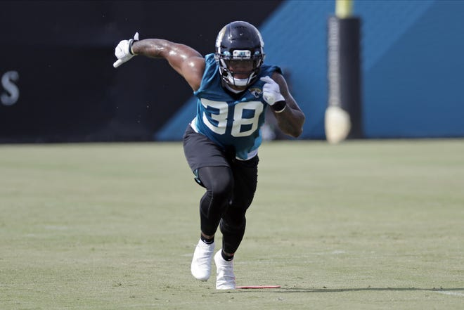 FILE - Jacksonville Jaguars running back James Robinson (38) performs a drill during an NFL football workout, Wednesday, Aug. 12, 2020, in Jacksonville, Fla. s stunning as Leonard Fournette's departure was from Jacksonville, his replacement might be equally surprising. Jacksonville expects to split the bulk of the work between second-year pro Devine Ozigbo and undrafted rookie James Robinson. (AP Photo/John Raoux, File)