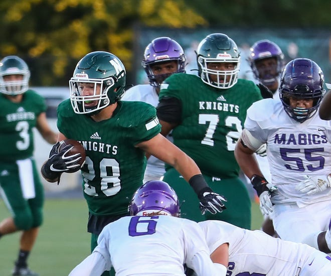 Nordonia running back Sal Perrine looks for room during the Knights' week two game vs. Barberton. Perrine ran for 222 yards and three touchdowns in Nordonia's 63-49 win at Wadsworth Sept. 11.