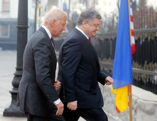 "Vice President Joe Biden, left, and Ukrainian President Petro Poroshenko go for talks during Biden's January 2017 visit in Kiev, Ukraine. The leaked recordings of apparent conversations between Joe Biden and Ukraine's then-president largely confirm Biden's account of his dealings in Ukraine. The choppy audio, disclosed by a Ukrainian lawmaker whom U.S. officials described Thursday as an ""active Russian agent"" who has sought to spread online misinformation about Biden."