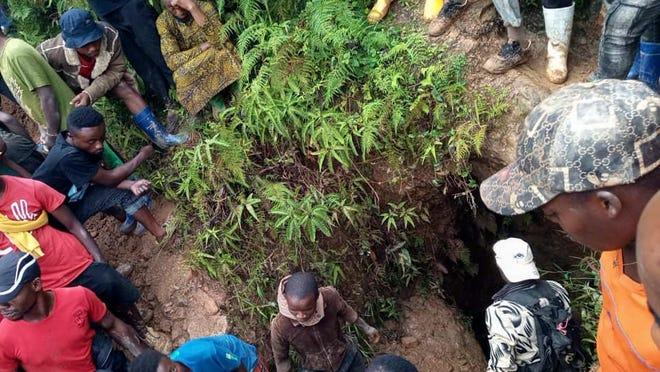 People gather at the scene of a gold mine collapse near the town of Kamituga, South Kivu province, in eastern Congo, on Friday.