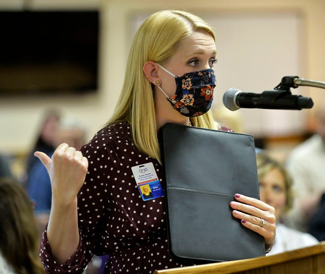 Custer Health Administrator Erin Ourada addresses the Morton County Commission on Thursday in Mandan, N.D. She spoke in favor of a mask mandate, which the commission rejected. Coronavirus infections in the Dakotas are growing faster than anywhere else in the nation, fueling impassioned debates over masks, personal responsibility and freedom after months in which the two states avoided the worst of the pandemic.