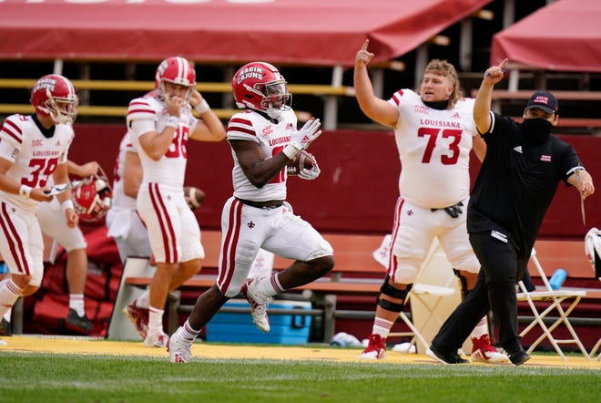 Louisiana-Lafayette running back Chris Smith, center, returns a kickoff 95-yards for a touchdown during the first half against Iowa State on Saturday in Ames, Iowa.