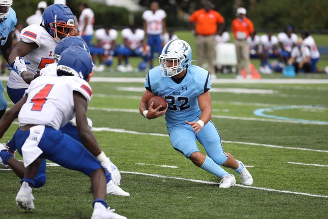 Keiser receiver Caleb Walls runs with the ball during Saturday's 62-0 rout of Florida Memorial.