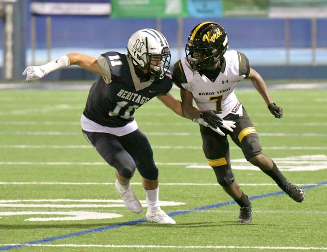 American Heritage cornerback Jason Riedy-Khaleel, right, squares up against Bishop Verot running back Kerby Joseph in coverage during Friday night's game between the two schools.