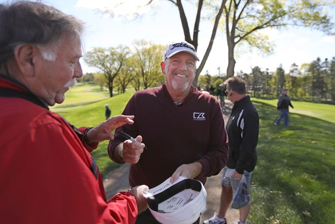 Jupiter's Mark Calcavecchia, shown autographing a hat for fan Dan Kelley at a PGA Tour Champions tournament last year in Rochester, N.Y., became the second player on the tour to test positive for COVID-19.
