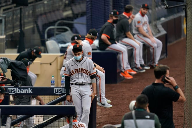 San Francisco Giants center fielder Mauricio Dubon wears a mask before the team's baseball game against the San Diego Padres on Friday in San Diego. Friday night's game was postponed minutes before the scheduled first pitch.