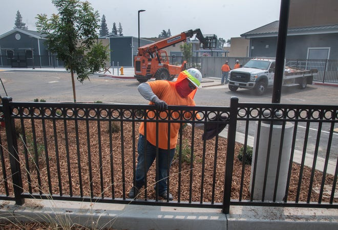 "Maurice Vargas with Stockton fence puts the finishing touches on a wrought iron fence at the new Flora Arca Mata Elementary School in Stockton. The school, named for the first Filipina teacher in California and the Stockton Unified School District, will open and allow staff on site on Monday. Mata, who died in 2013 at age 95, became the district's first Asian-American teacher in 1948, one year after Wilhelmina Henry became the school district's first Black teacher.  She taught in Stockton Unified until her retirement in 1978. Mata was born in Honolulu in 1917, and her family moved to the Little Manila section of Stockton in the early 1920s. ""To be first is not that important,"" Mata told The Record in 1975. ""It's what you do after that that's important."""