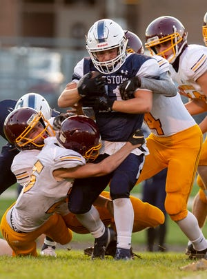 Rootstown junior Brandan Nicholas is brought down by a host of Southeast defenders during Friday night's game at Rootstown.