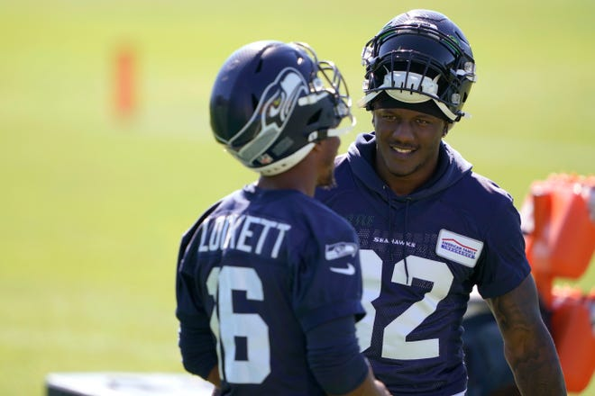 Wide receiver Tyler Lockett, left, running back Chris Carson and the Seattle Seahawks open their season Sunday against the Atlanta Falcons in Atlanta.
