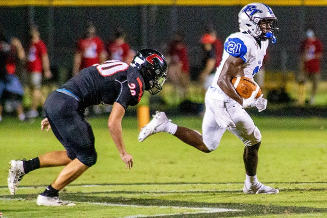 Bartram Trail running back Eric Weatherly evades a tackle on a 52-yard punt return against Creekside.