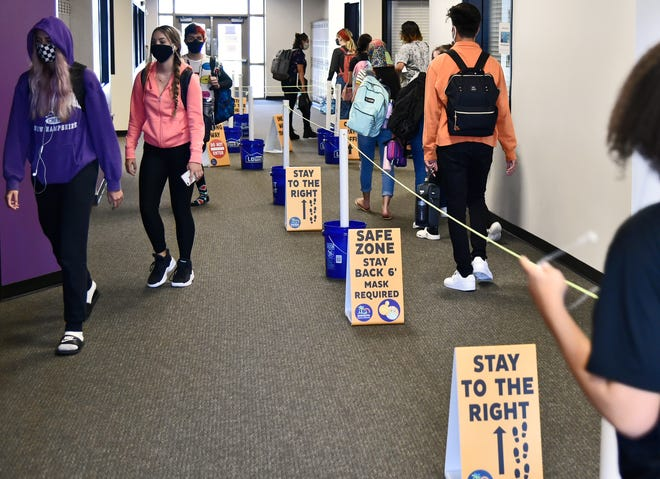 Students change classes recently at Booker High School, where measures have been taken across the campus to facilitate social distancing.