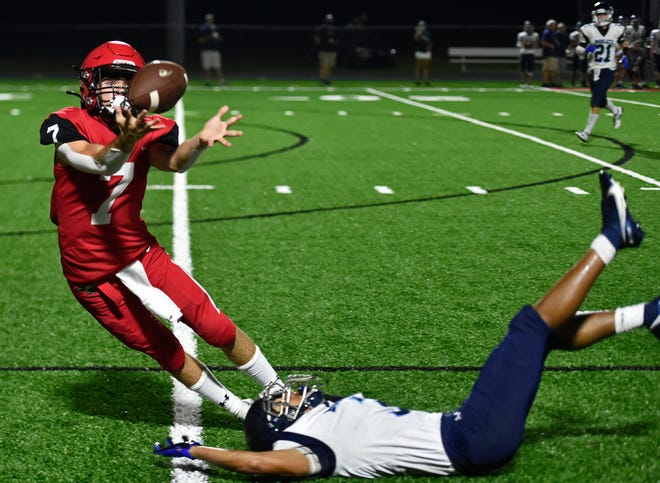 Cardinal Mooney's Will Zerega comes up with the pass during the third quarter against North Port High at John Heath Field at Austin Smithers Stadium in Sarasota.