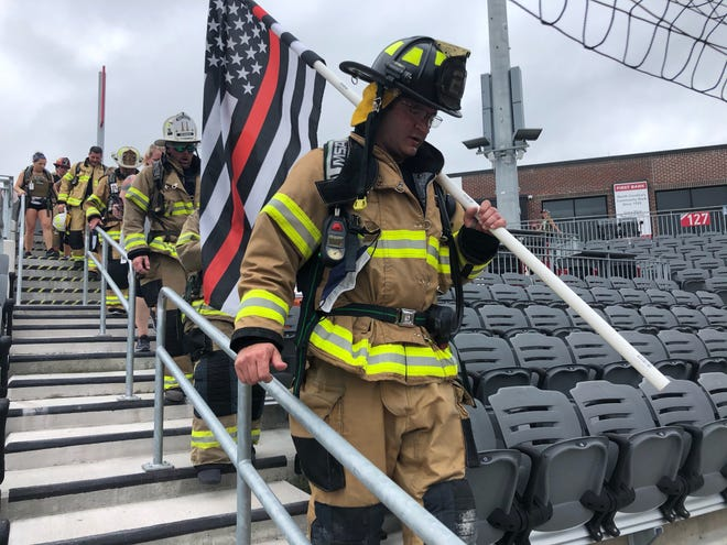 Firefighters were among the participants of the 9/11 Memorial Stair Climb Saturday at Segra Stadium in downtown Fayetteville. [Rachael Riley/The Fayetteville Observer]