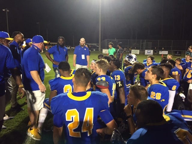 Newberry coaches talk to the team following Friday's win over Trenton.