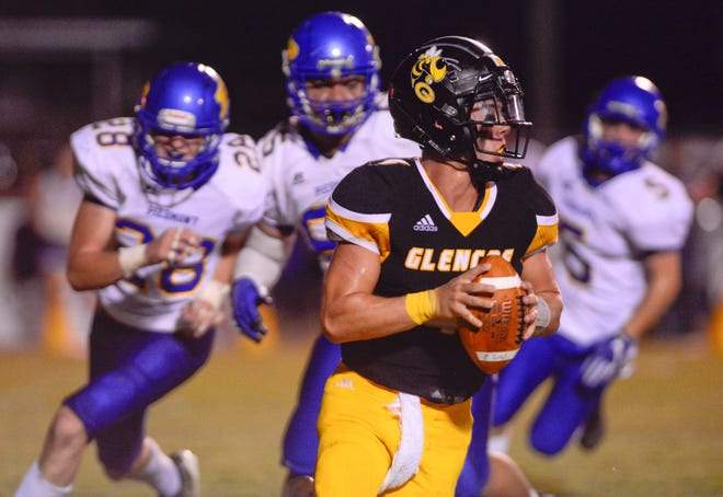 Glencoe quarterback Nolan Fairley rolls out to avoid pressure against Piedmont on Friday, Sept. 11, 2020.