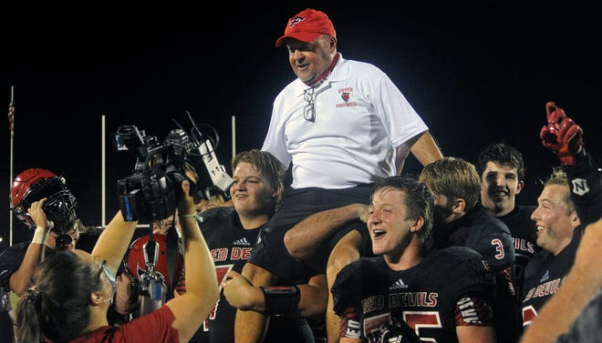 Fyffe players hoist coach Paul Benefield on their shoulders and carry him off the field after beating Sylvania 49-20 Friday, Sept. 11, 2020, at Paul Benefield Stadium. The win was the 300th of Benefield's career.