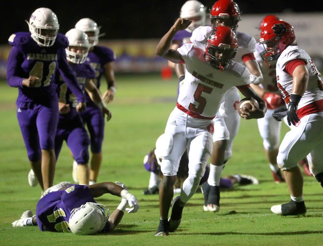Blountstown's Ken Speights (5) celebrates as he runs in a touchdown. Marianna faced off with Blountstown for a football game on Sept. 11, 2020.