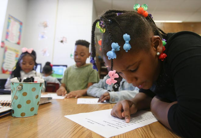 Kaylie Mitchell, 6, reads aloud during small group reading time at a table in Carissa Sterling's kindergarten class at Martin Luther King, Jr. Elementary School in Tuscaloosa on Thursday, March 8, 2018.  [Staff file photo]