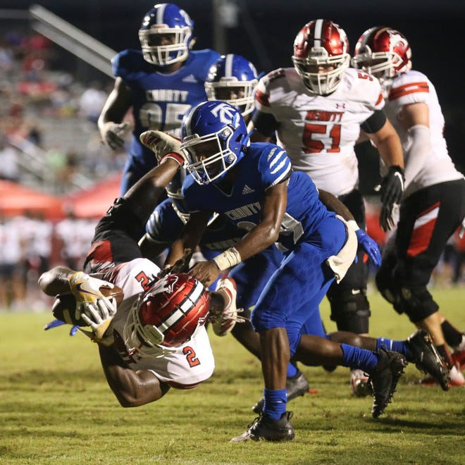Hewitt-Trussville running back Armoni Goodwin (2) dives into the end zone past Tuscaloosa County linebacker Christian Thomas (24) at Tuscaloosa County High School Friday Sept. 11, 20202. [Staff Photo/Gary Cosby Jr.]
