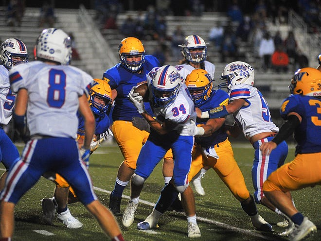 Wooster's defensive line engulfs West Holmes' Emmett Myers during the Generals' 38-14 win.